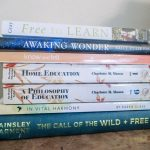 The best homeschooling books in a stack with titles visible.